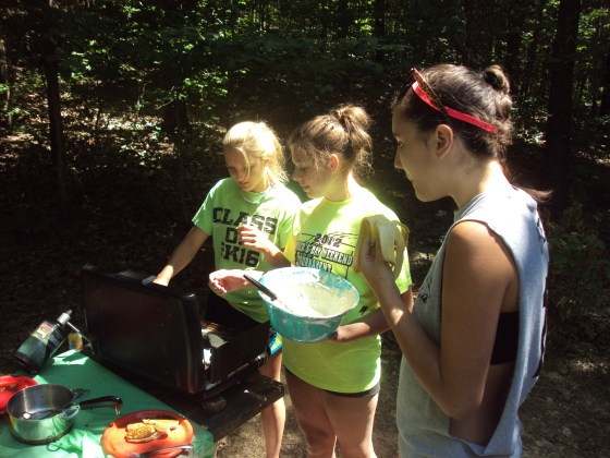 Youth making pancakes on the summer retreat